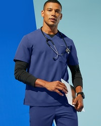 Man in galaxy blue scrub top and pant