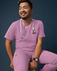 man in mauve colored scrubs