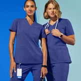 women in galaxy blue scrub tops and pants